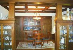 Dining room with built-in curio cabinets, sideboard and beamed ceiling