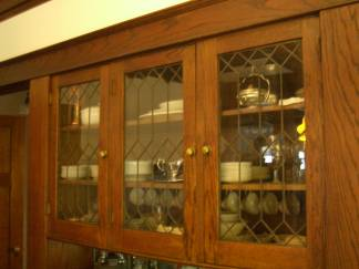 Dining room detail - leaded-glass doors on sideboard